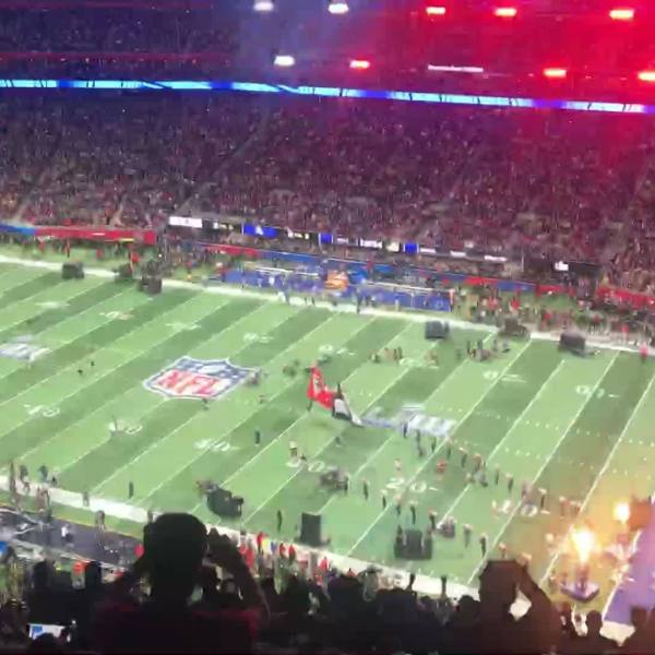 At the Super Bowl, eyes on iPhones not the field