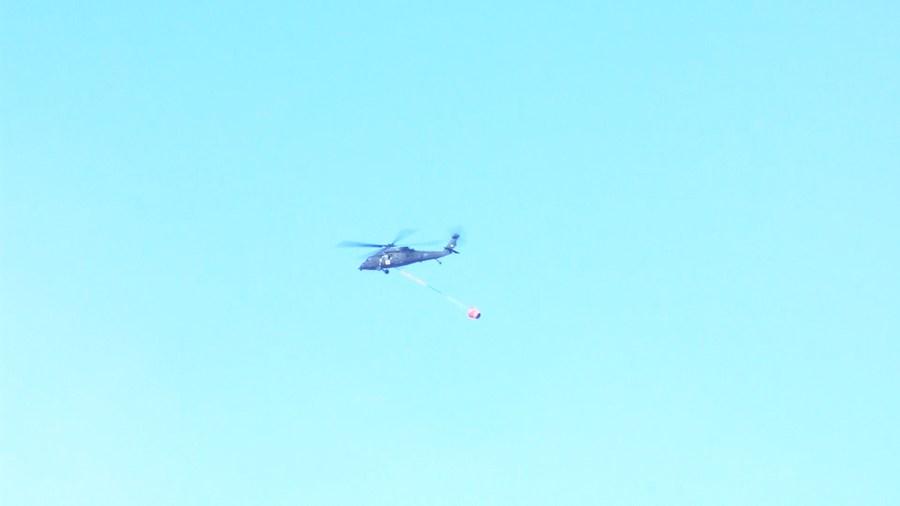 Helicopter flies over Schroeder fire