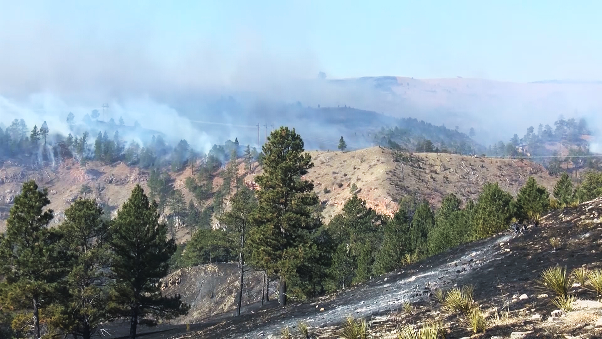 Smoke over area burned by Schroeder fire